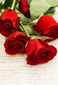 Red rose flowers and old love letters — Stock Photo