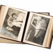Stock Photo: Open antique album with baby photos