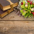Bouquet of orchid flowers and old books — Stock Photo