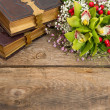 Bouquet of orchid flowers and old books — Stockfoto