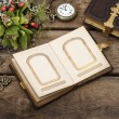 Old photo album over rustic wooden background — Stock Photo