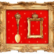 Old golden frame with red background - Stock Photo