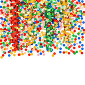 Colorful confetti with shiny streamer over white — Stock Photo