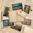 Open old book and postcards with pictures of florence — Stock Photo