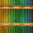 Long old golden frame over colorful wooden wall — Stock Photo