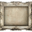 Antique silver frame with empty grunge canvas — Stock Photo