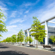Moderne urbcity landscape with trees and sky — Stock Photo #26455101