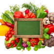Blackboard with fresh organic vegetables and herbs — Stock Photo
