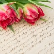 Soft pink tulips with old handwritten love letter — Stok fotoğraf