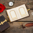 Stock Photo: Antique photo album with red rose flower