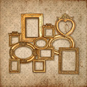 Golden framework over vintage pattern wallpaper — Stock Photo