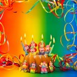 Birthday cake with candles and colorful decoration — Stock Photo #26661385