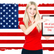 Young woman with american national flag — Stock Photo #26661387