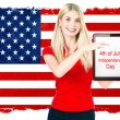 Young woman with american national flag — Stok fotoğraf