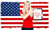 Young woman with american national flag — Stock Photo
