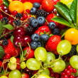 Mix of fresh fruits and berries. raw food ingredients — Stock Photo
