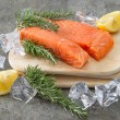 Raw salmon fillet with fresh rosemary herb, lemon and ice — Stock Photo
