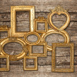 Antique golden framework rustic wooden wall — Stock Photo