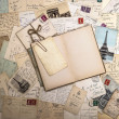 Stock Photo: Old postcards and open book. nostalgic vintage background