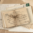 Old letters and antique french postcards — Stock Photo