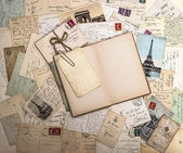 Old postcards and open book. nostalgic vintage background — Stock Photo