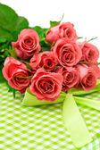 Fresh pink roses with gift over white background — Stock Photo