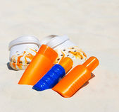 Beach accessories. sunblock cream and summer shoes — Stock Photo