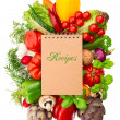 Recipe book with fresh organic vegetables and herbs — Stock Photo