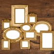 Antique golden framework over rustic wooden wall — Stock Photo