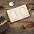 Stock Photo: Antique photo album with butterfly over wooden background