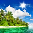 Landscape of tropical island beach with sunny blue sky — Stock Photo #28714801