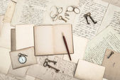 Open book, vintage accessories, old letters and postcards — Stock Photo