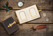 Antique photo album with butterfly over wooden background — Stock Photo