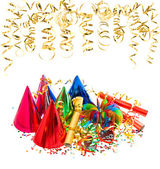 Colorful garlands, streamer, party hats and confetti — Stock Photo
