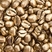 Closeup of golden coffee beans. food and beverages — Stock Photo