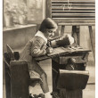 Stock Photo: Vintage sepia portrait of a first grader school girl in the clas
