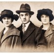 Stock Photo: Antique portrait of young people wearing vintage clothing