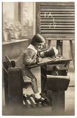 Vintage sepia portrait of a first grader school girl in the clas — Stock Photo