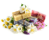 Soap bars with fresh lavender and chamomile flowers — Stock Photo