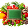 Stock Photo: Fresh vegetables and herbs with chalkboard