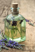 Essential herbal lavender oil with fresh flowers — Stock Photo