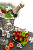 Champagne and strawberries — Stock Photo