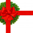 Red ribbon bow and green christmas wreath — Stock Photo