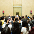 Visitors take photos of Mona Lisa — Stock Photo