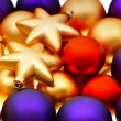 Lila, red and golden baubles — Stockfoto