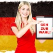 Young woman with Tablet PC and Germany flag on background — Stock Photo #31300419