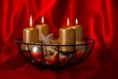 Burning golden candles and christmas balls — Stock Photo