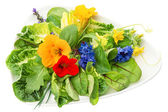 Green salad with flowers — Stock Photo