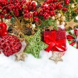 Baubles, golden garlands, christmas tree and red berries — Stock Photo #34984383