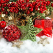 Baubles, golden garlands, christmas tree and red berries branche — Stock Photo #34984397